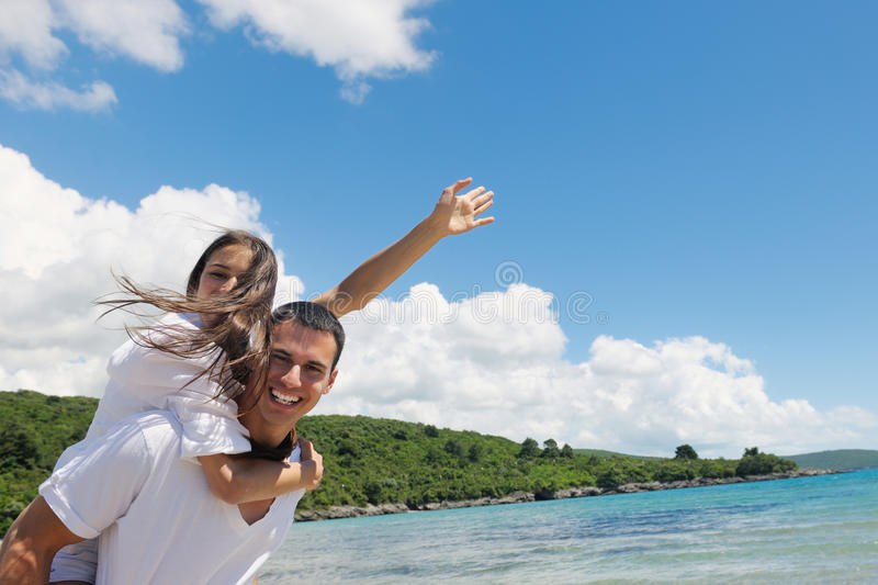 Happy couple have fun on the beach. Happy young couple have fun and relax on the beach royalty free stock image