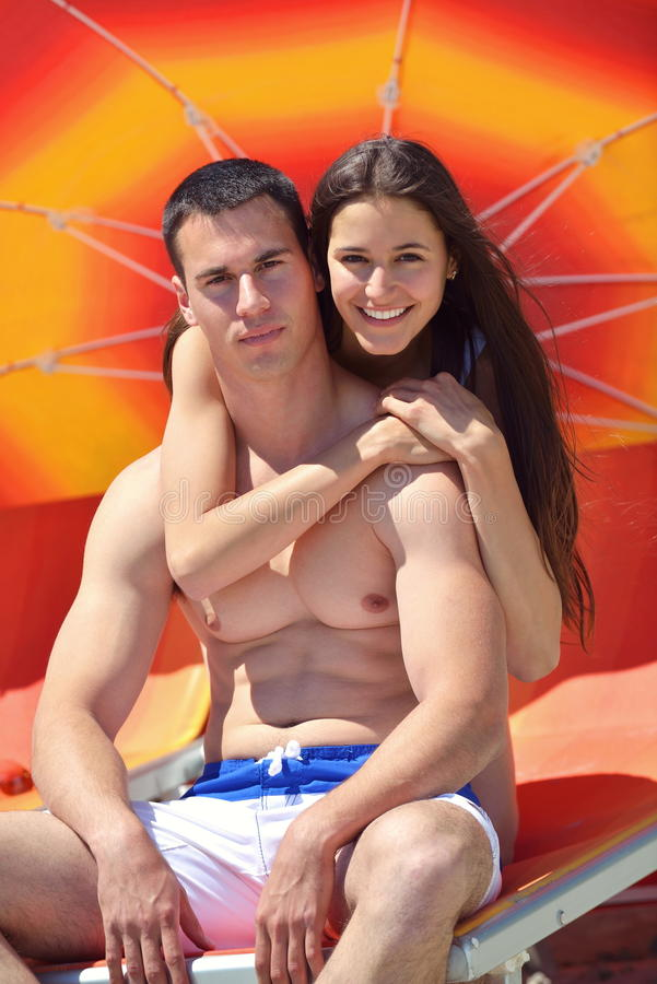 Happy couple have fun on the beach. Happy young couple have fun and relax on the beach stock photo