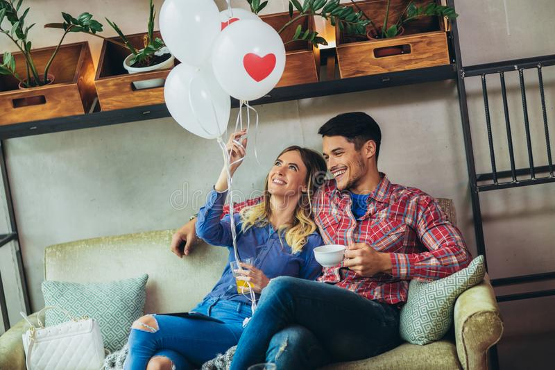 Couple have fun in cafe celebrating Valentine`s Day. stock images