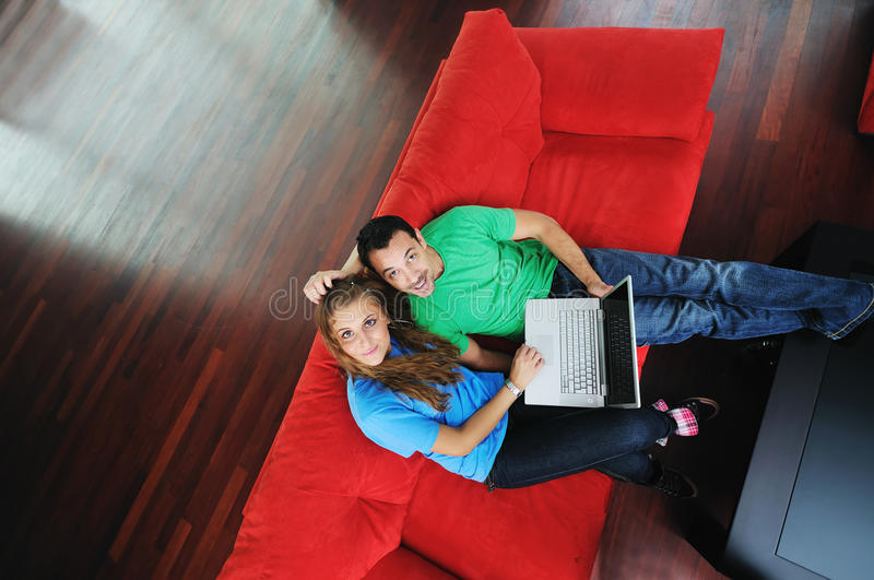 Download Happy Couple Have Fun And Work On Laptop At Home Stock Photo - Image: 11334180