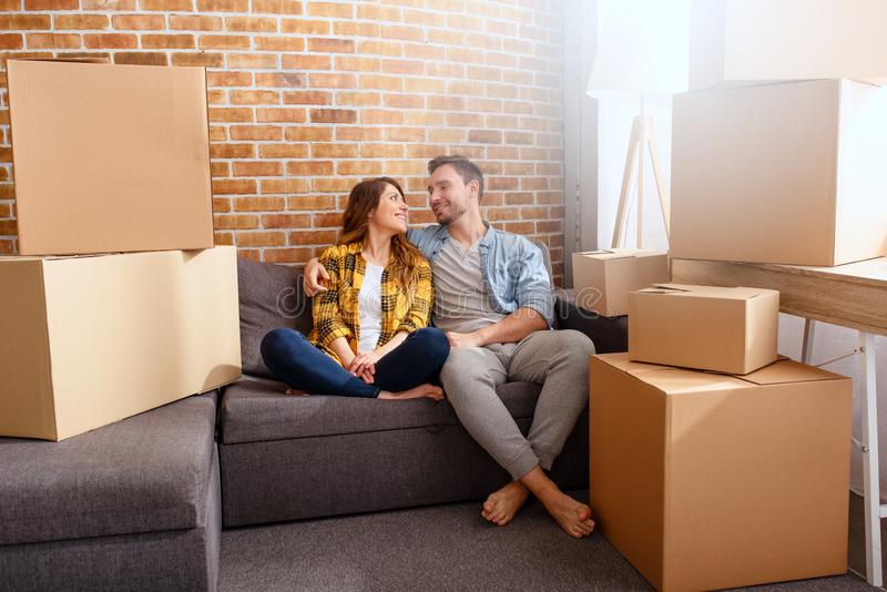 Happy couple have to move and arrange all the packages. Concept of success, change, positivity and future royalty free stock images