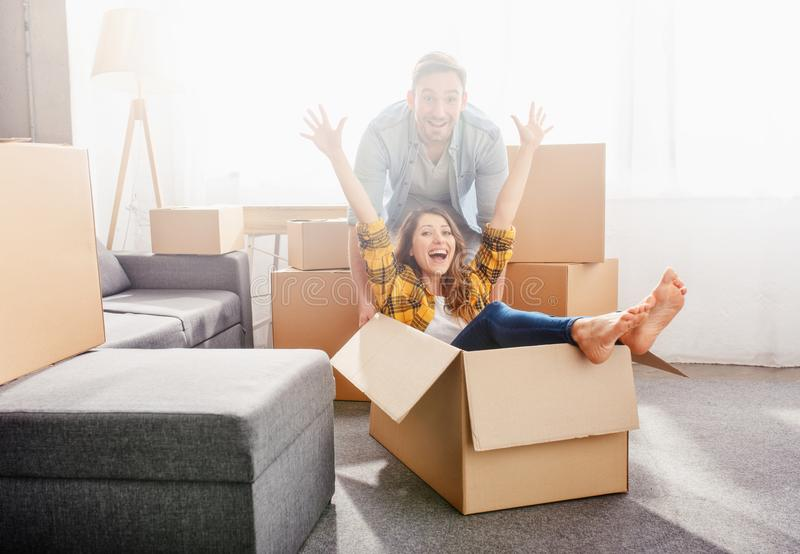 Happy couple have to move and arrange all the packages. Concept of success, change, positivity and future stock photo