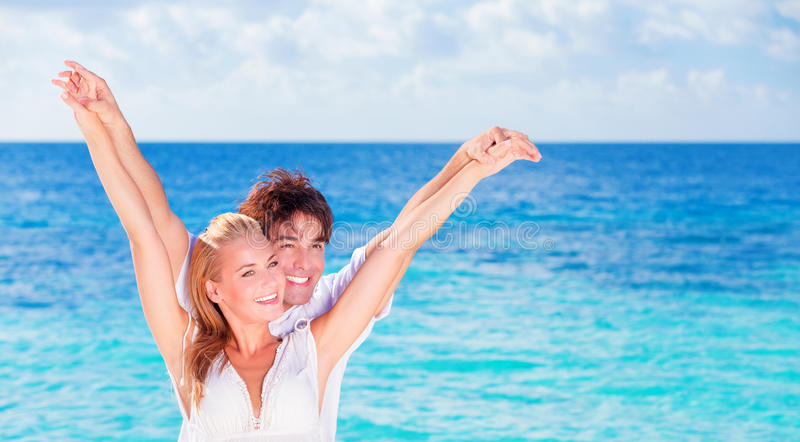 Happy couple having fun on the beach royalty free stock photography