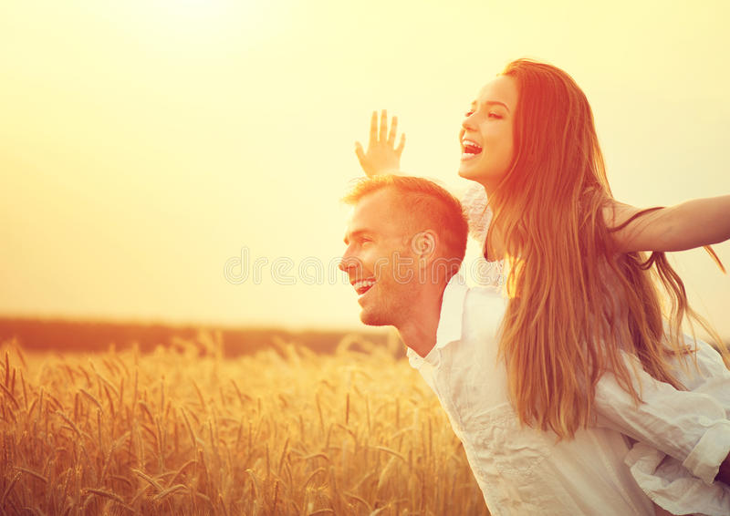 Happy couple having fun outdoors on wheat field royalty free stock image
