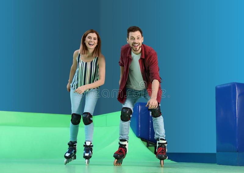 Happy couple at roller skating rink. Happy couple having fun at roller skating rink royalty free stock photos