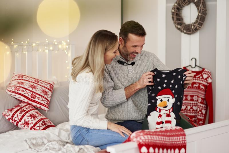 Happy couple having fun at Xmas stock image