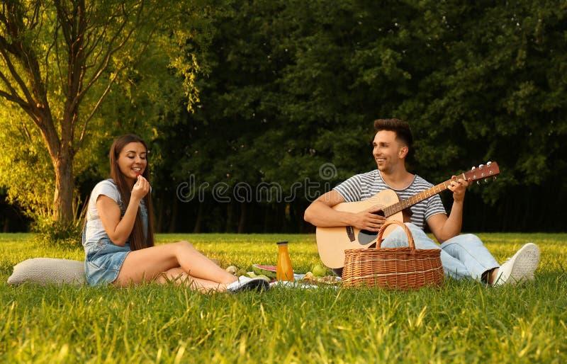 Happy couple having picnic on sunny day royalty free stock photos