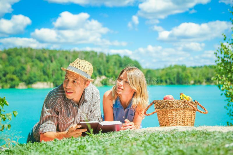 Happy couple having picnic by the sea in nature stock images