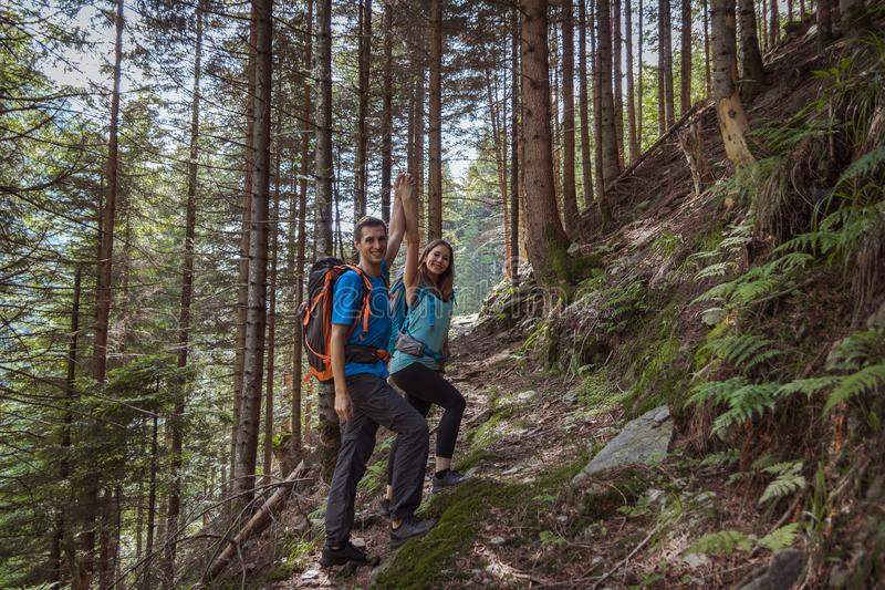 Strong couple hiking in the mountains royalty free stock photos