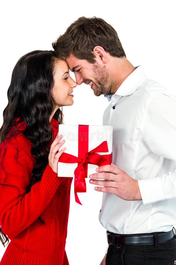 Happy couple holding gift box stock image