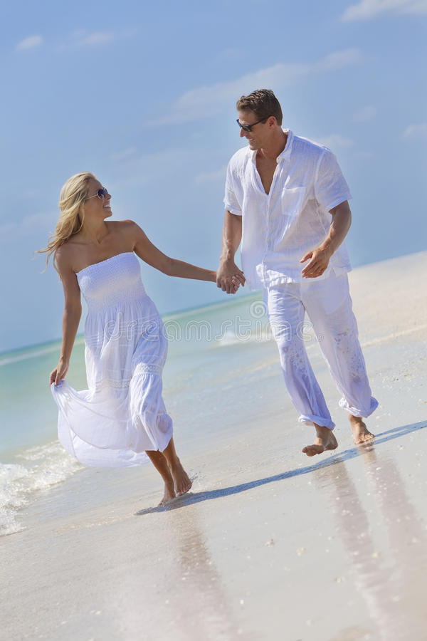 Download Happy Couple Holding Hands On A Tropical Beach Stock Photo - Image: 16276840