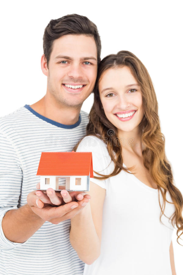 Happy couple holding miniature house royalty free stock images