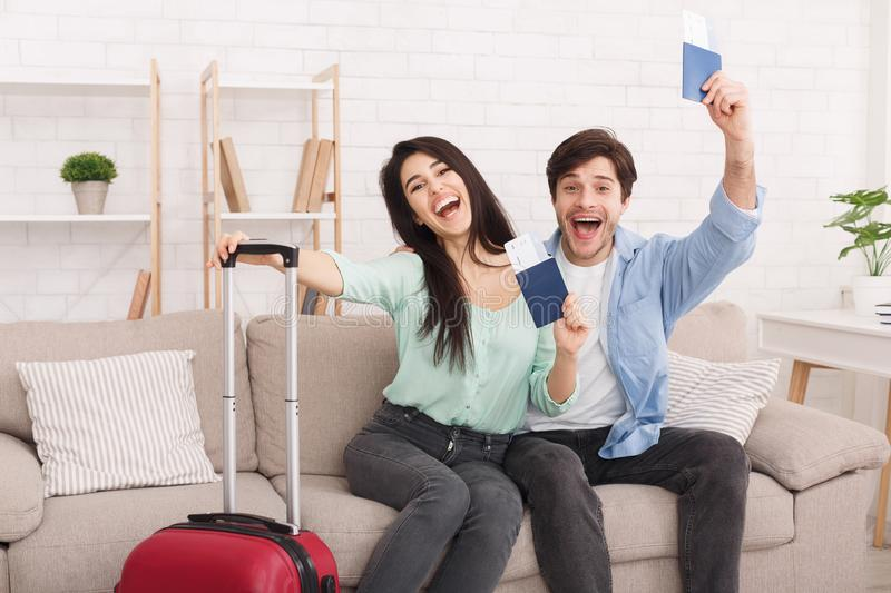 Happy couple holding passports and tickets in hands royalty free stock images