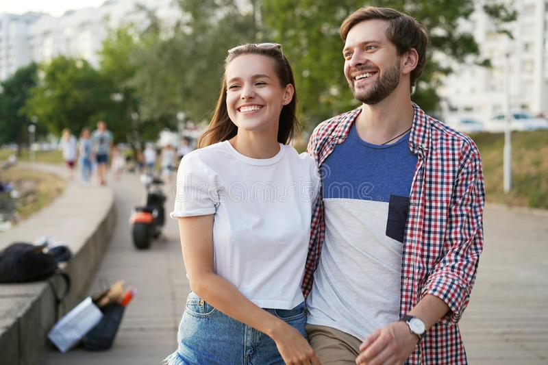 Happy couple on holidays walking around the city and smiling royalty free stock photos