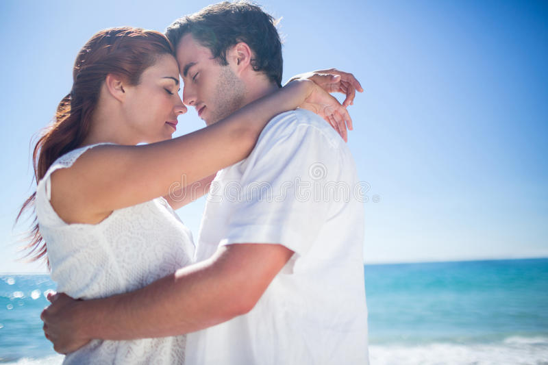 Happy couple hugging eyes closed royalty free stock photos