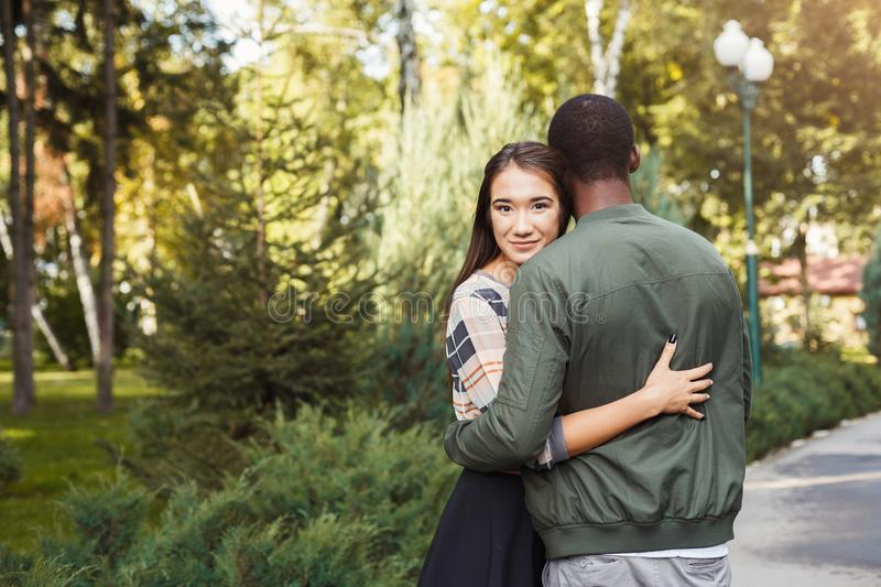Happy couple hugging in park copy space royalty free stock images