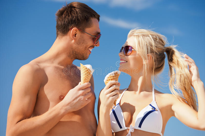 Happy couple with ice cream royalty free stock image