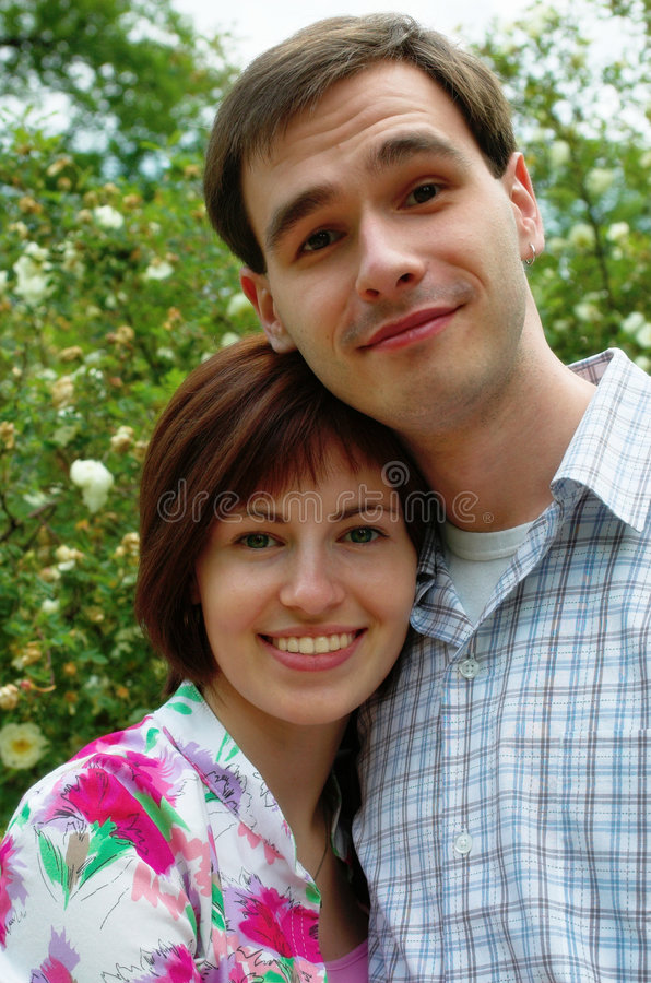 Free Happy Couple In The Flower Royalty Free Stock Image - 1059376