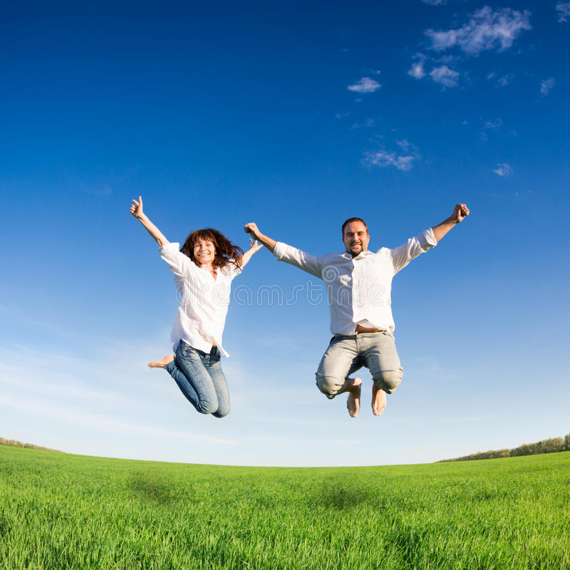 Happy couple jumping stock photography