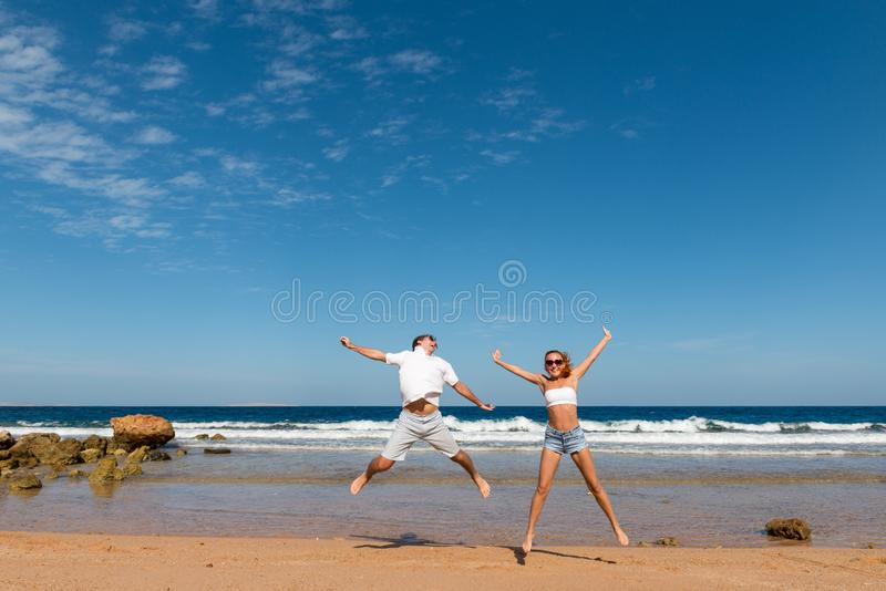 Happy couple jumping stock image