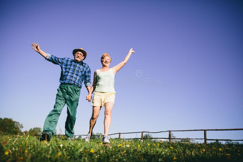 Happy couple jumping and waving. stock images