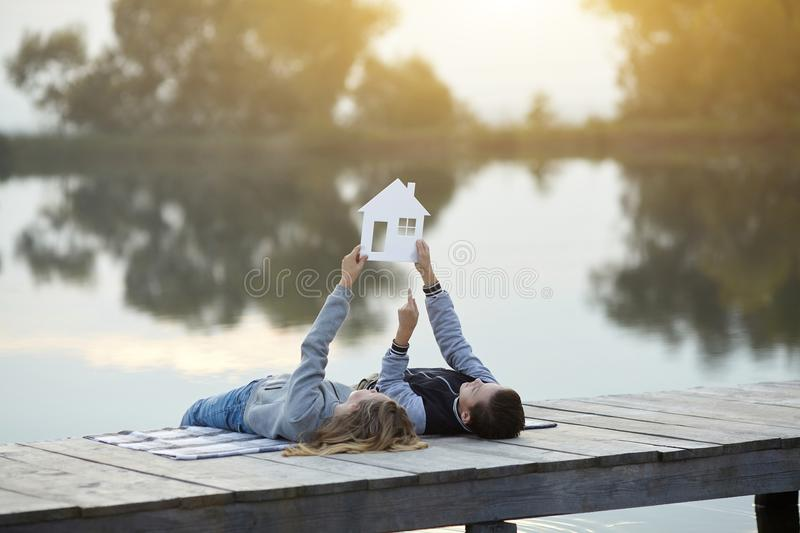Happy couple of kids dream of a home royalty free stock photography