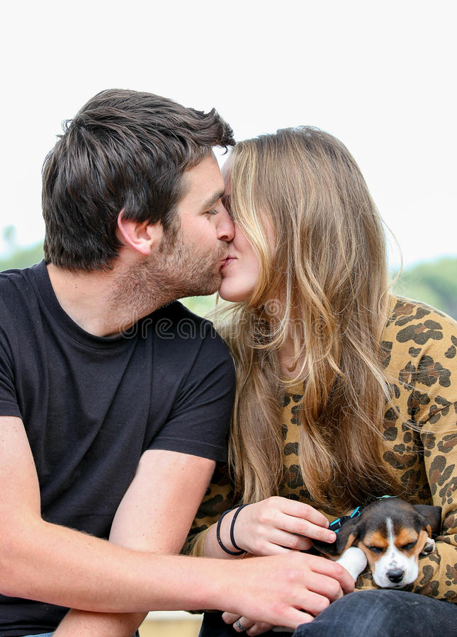 Happy couple kissing stock images