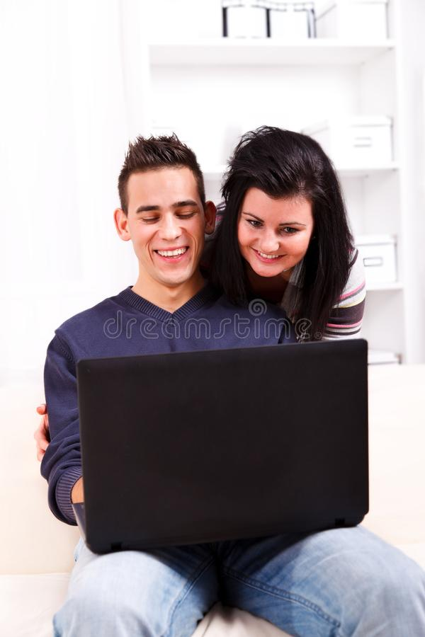 Happy couple with laptop royalty free stock images