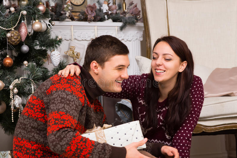 Happy Couple Laughing Near the Christmas Tree royalty free stock photos