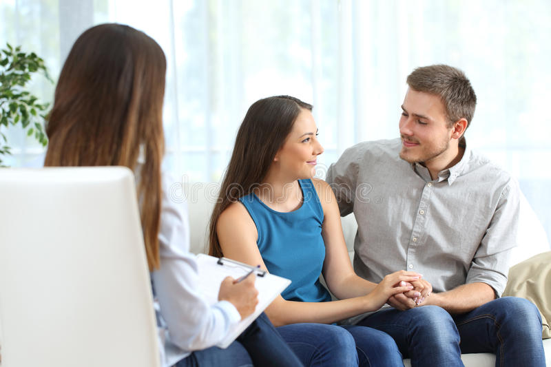 Happy couple listening to marriage counselor stock photos