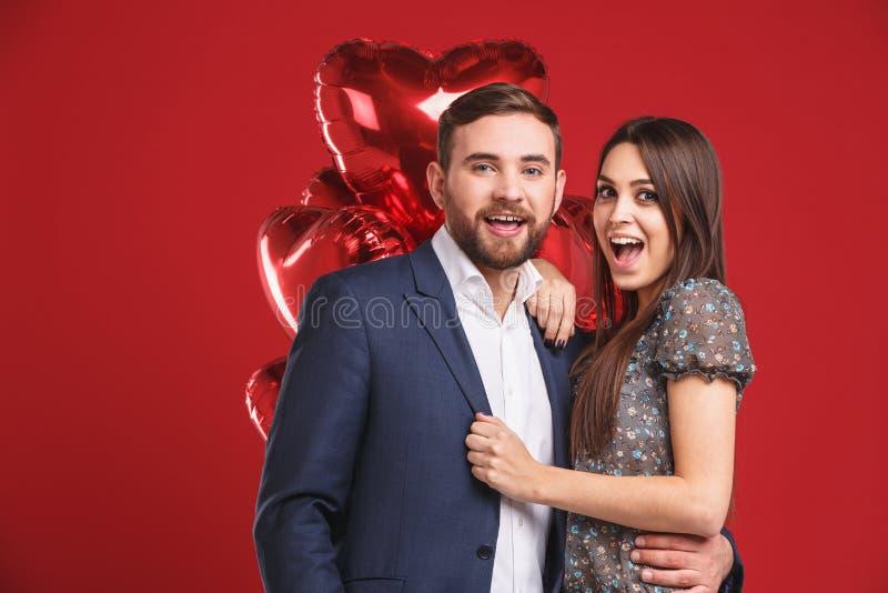 Happy couple looking at camera. royalty free stock image
