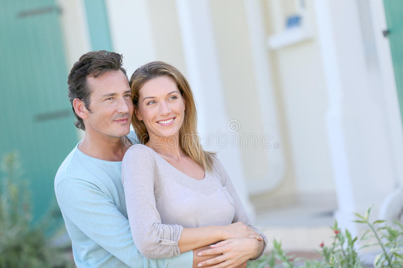 Happy couple looking towards the future royalty free stock image