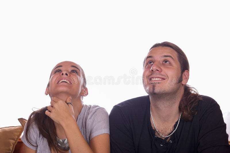 Happy couple looking up stock photography