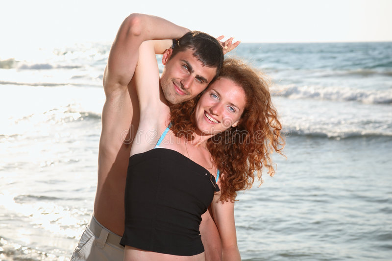 Happy couple in love. Young happy couple in love having fun outdoors royalty free stock images