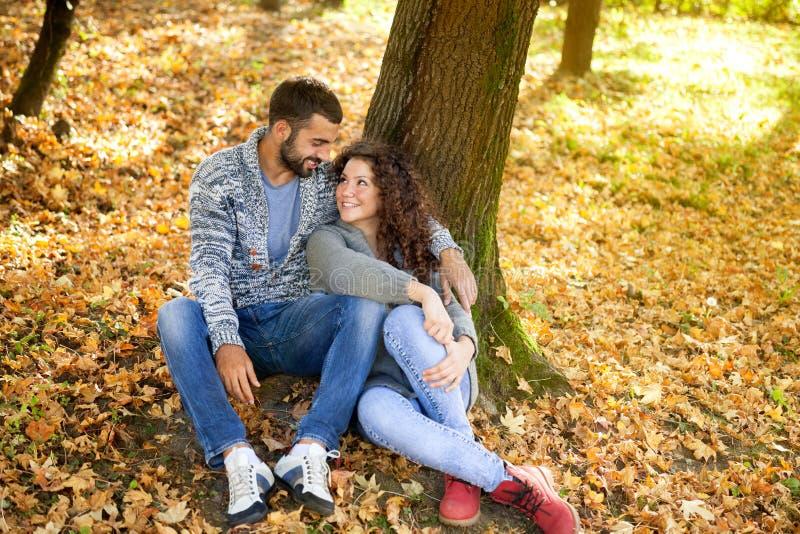 Happy couple in love in autumn park stock photo