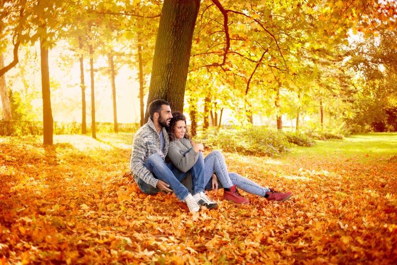 Happy couple in love in autumn park stock photos