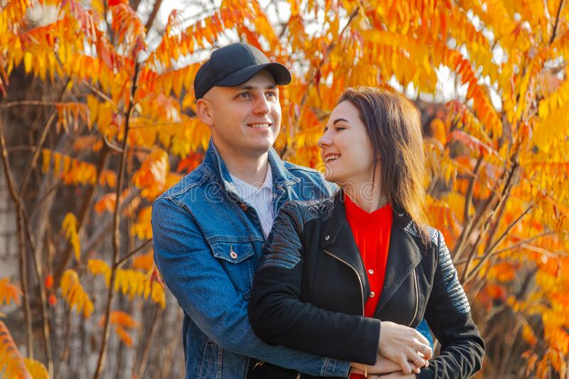 Happy couple in love on a background of yellow leaves in autumn. Happy couple in love on a background of yellow leaves in autumn stock photos
