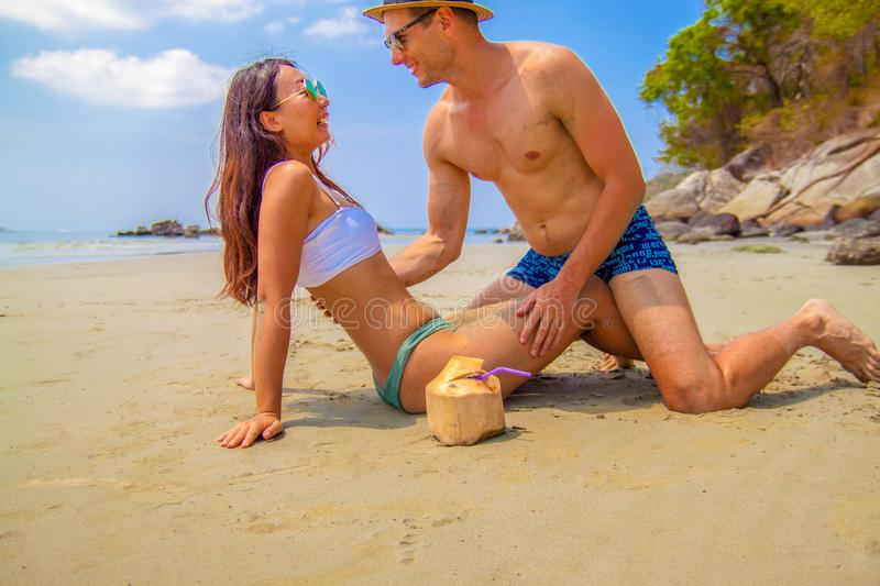 Happy couple in love on beach summer vacations. royalty free stock images