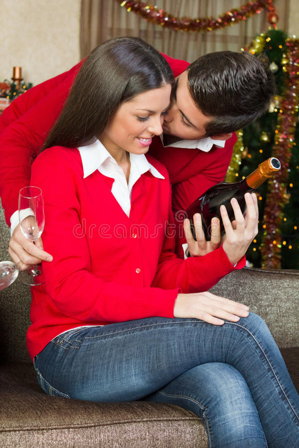 Happy couple in love in christmas night. Couple at home in christmas night stock images