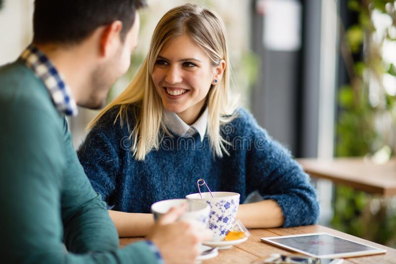Happy couple in love dating. And drinking coffee stock image