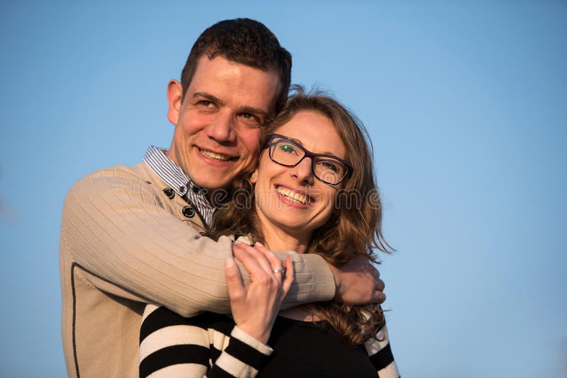Happy couple in love on engagement day in natural park. stock photography