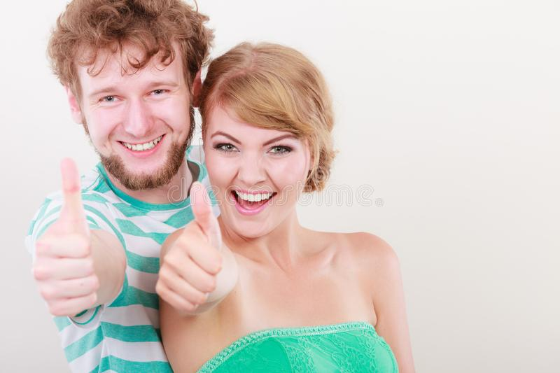 Happy couple excited smiling holding thumb up gesture royalty free stock images