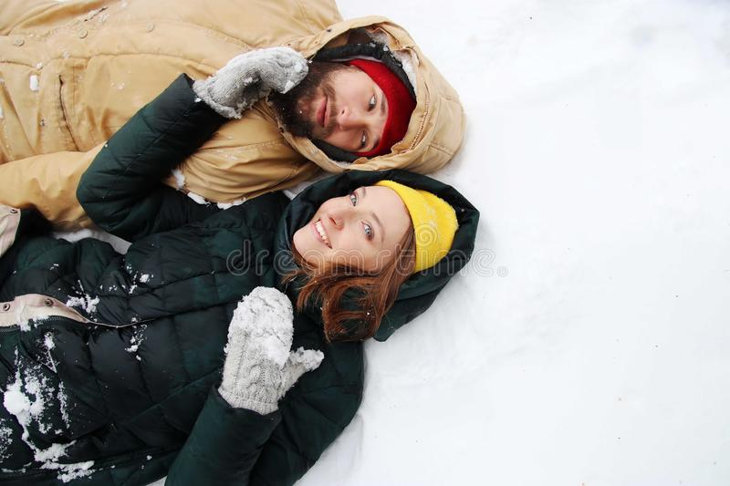 Happy couple in love having fun in the snow. royalty free stock image