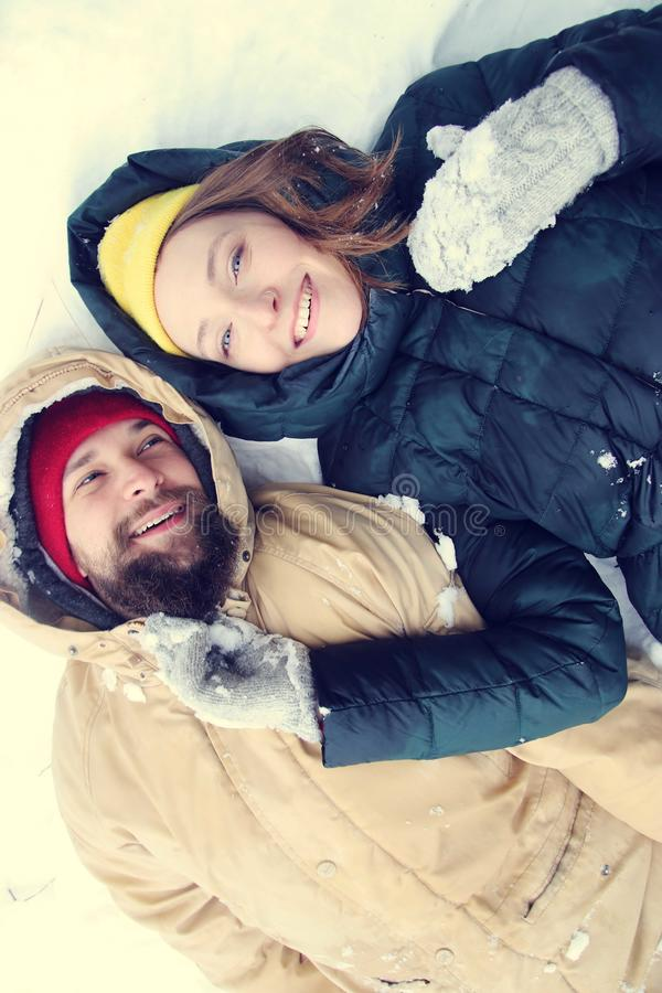 Happy couple in love having fun in the snow. royalty free stock photos
