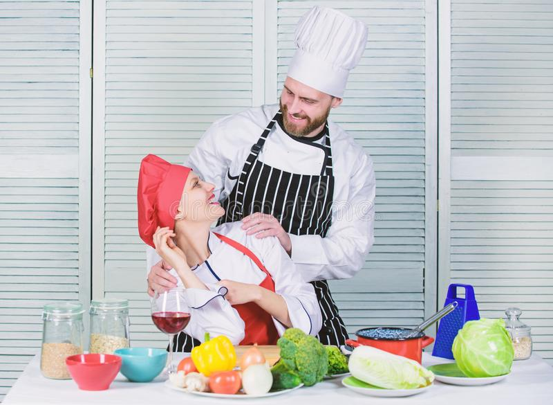 Happy couple in love with healthy food. Dieting and vitamin. culinary cuisine. happy man and woman chef in restaurant royalty free stock images