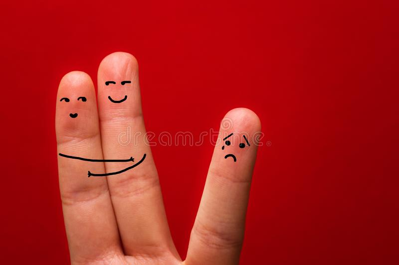 Happy couple in love, holds heart and third wheel - Image.  royalty free stock photography
