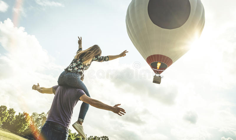 Happy couple in love on honeymoon vacation at hot air b royalty free stock images