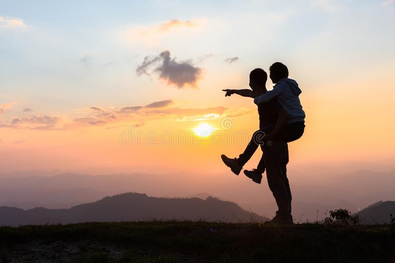 Happy couple in love. Man and woman tourists in the mountains. Happy Valentine`s Day stock image