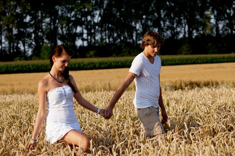 Happy Couple In Love Outdoor In Summer On Field Royalty Free Stock Photo