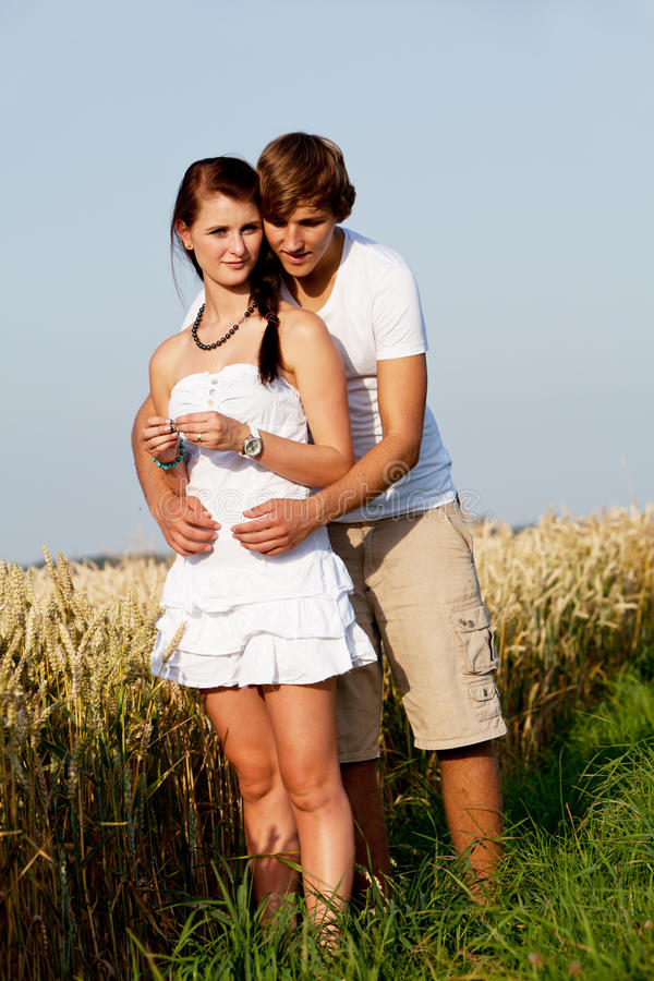 Happy Couple In Love Outdoor In Summer On Field Stock Photo